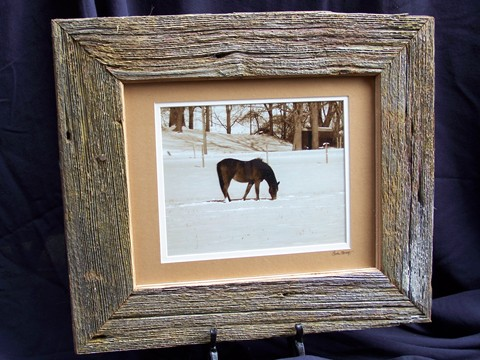 the handcrafted frame which it sits in is made of barn wood that is over a century old this wood was reclaimed from fallen barns in erie county